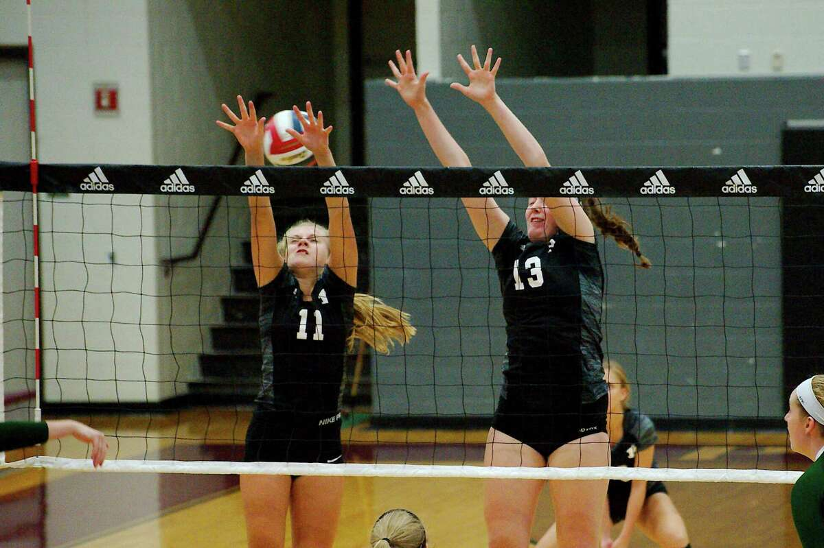 Pearland's Katie Whitehead (11) and Pearland's Sam Demmon (13) go high to block a shot against John Cooper School at the Adidas Texas Volleyball Invitational Thursday, Aug. 11.