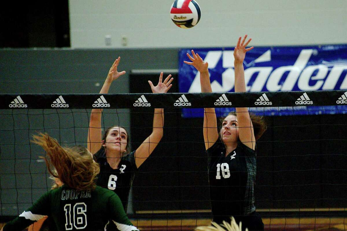 Pearland's Morgan DeBorde (6) and Pearland's Sam Costello (18) try to block a shot at the net against John Cooper School at the Adidas Texas Volleyball Invitational Thursday, Aug. 11.