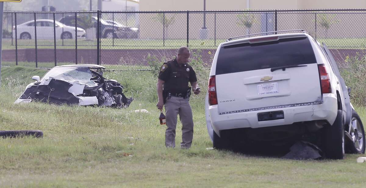 A member of the Fort Bend County Sheriff's dept. is shown at the scene of a fatal head-on collision on Beechnut between FM 1464 and Westmoor Friday, August 12, 2016.( Melissa Phillip / Houston Chronicle )