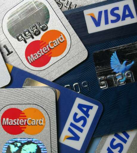 This file photo taken Nov. 18, 2009, shows a pile of MasterCard and VISA credit cards in Frankfurt, Germany. Heads are still spinning over credit card bills and charges. A law that went into effect in February 2010, requires banks to provide numerous consumer protections, including clearer monthly statements. Yet confusion about some practices remains widespread. (AP Photo/Jochen Krause, File) Photo: Jochen Krause, AP