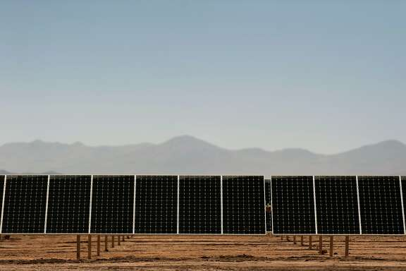Picture taken on January 23, 2015 of the newly finished PV Salvador solar plant near El Salvador, in the Atacama desert, northern Chile. The photovoltaic plant, built by SunPower, a California-based branch of Total, with a maximum output of 70 Megawatts, is one of the world biggest solar plants. AFP PHOTO/Vladimir Rodas        (Photo credit should read VLADIMIR RODAS/AFP/Getty Images)