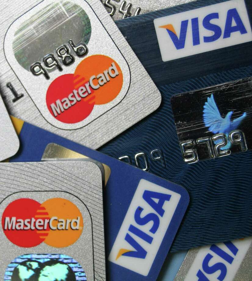 San Antonio-based Payment Data Systems Inc. reported that lower credit and debit card processing fees led to a 21 percent drop in revenue and a loss for the fourth quarter of last year. Photo: Associated Press /File Photo / AP2009