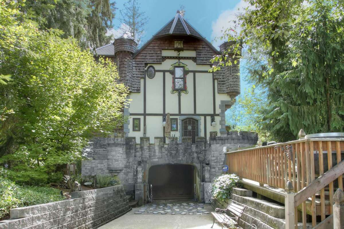 The design for the home was originally sketched on a napkin. It was based on the castles the Denning toured in Europe. This is the entrance to the dungeon (also known as a basement, or one-car garage). You can see the full listing here.