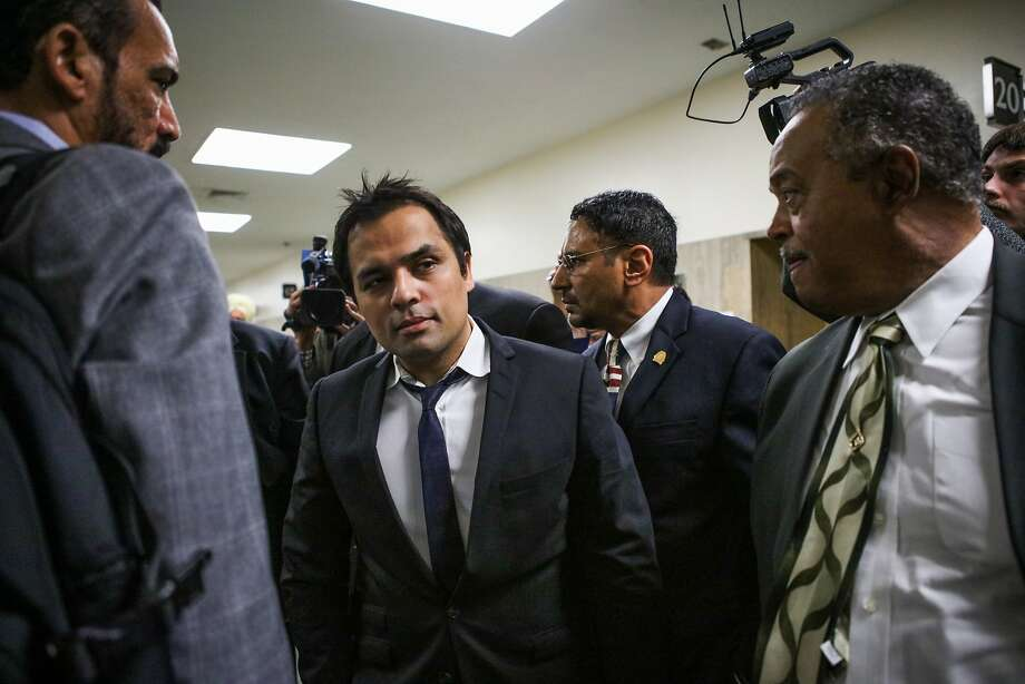 In this April 22, 2016 photo, Gurbaksh Chahal, center, a millionaire tech mogul, walks out of court at the Hall of Justice in San Francisco. Chahal is facing possible jail time for violating his probation in a domestic violence case. Prosecutors say he violated his probation by attacking a second girlfriend. Photo: Gabrielle Lurie, Associated Press