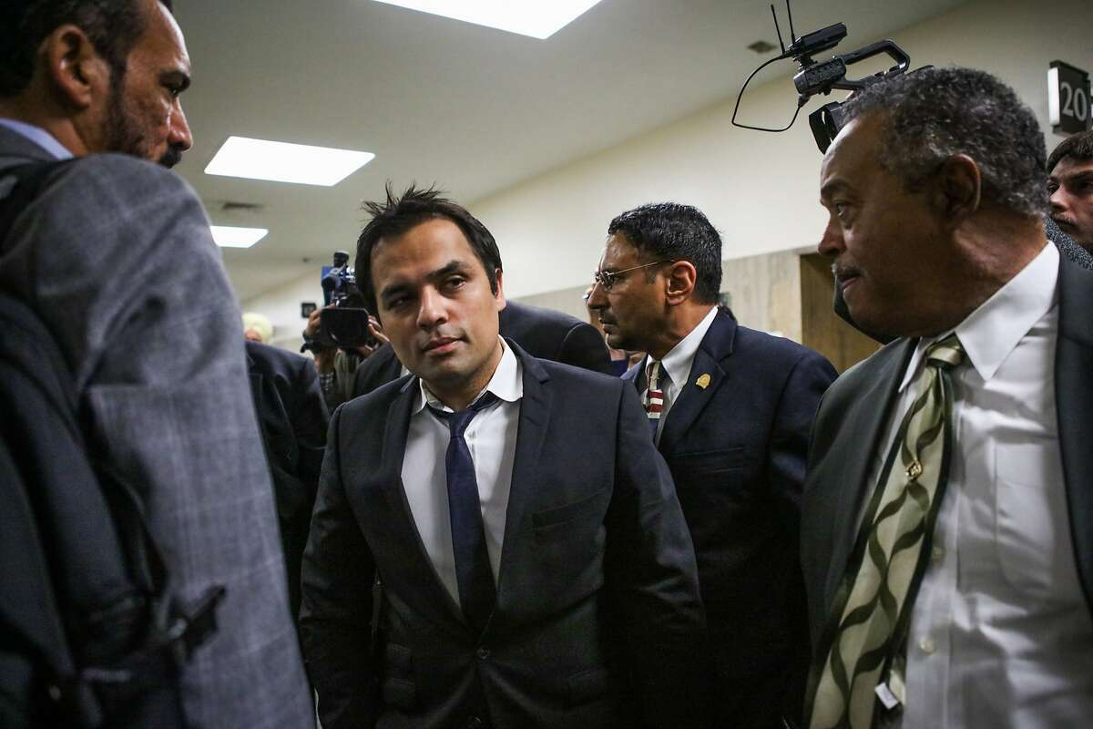 In this April 22, 2016 photo, Gurbaksh Chahal, center, a millionaire tech mogul who is being convicted of domestic abuse walks out of court at the Hall of Justice, in San Francisco. Chahal is facing jail time for violating his probation in a domestic violence case. San Francisco Superior Court Judge Tracie Brown is scheduled to sentence Chahal on Friday, Aug. 12, 2016. Prosecutors say he violated his probation by attacking a second girlfriend, and Brown ruled in their favor last month. (Gabrielle Lurie/San Francisco Chronicle via AP)