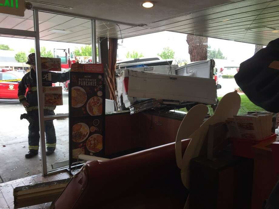 A pickup truck slammed through a glass wall at a Denny's in Fremont Friday morning, leaving a worker at the Mowry Avenue restaurant hospitalized with minor injuries. Photo: Fremont Fire Department / /