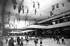 11/15/1986 - Skaters' reflections in mirrors over part of the Galleria ice rink.