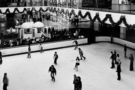 11/28/1976 - Ice skaters on the Galleria shopping complex ice rink avoid the cold weather outdoors on Sunday afternoon.