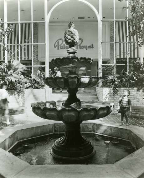 October 1968: Children and parents alike enjoy the park-like surroundings of Northwest Mall. The architectural highlight of the mall was the arboretum area featuring this 21 feet high fountain and various tropical plants and trees. Photo: Houston Chronicle