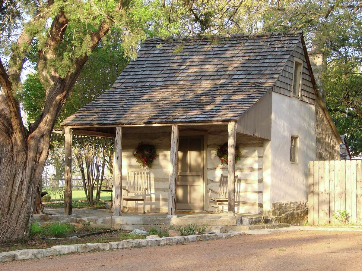 The Adolph and Martha Wunderlich house was built in the Live Oak community, which is near Fredericksburg. The log house with a rock kitchen was bult in the late 1880s. Log-and-rock houses like this one were usually built as starter houses for German families,but they lasted for a long time.
