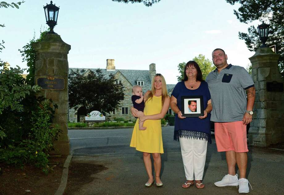 Family members of the late Joseph Cote; daughter Ashley Cote Smith with her son, Dez Joseph Smith, 7 months old, wife Terry Cote, and son Joseph Cote Jr., at Cranbury Park in Norwalk. The Cranbury Park entrance will be named Joseph Cote Way after the 40-year employee of Norwalk Department of Recreation and Parks who died last year of leukemia. Photo: Erik Trautmann / Hearst Connecticut Media / Norwalk Hour