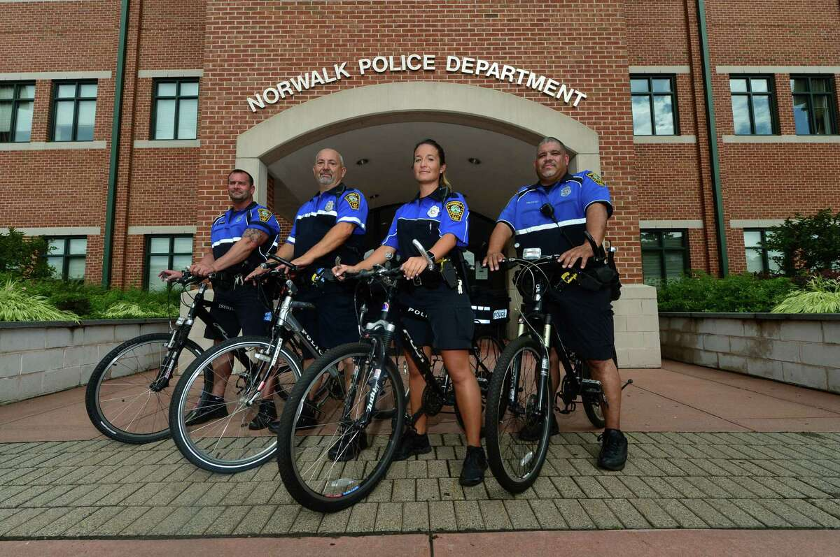 Norwalk police officers, Dave Vetare, Russell Oullette, Cristina Capela, and Hector Delgado, are part of the Norwalk Police Department bicycle unit in Norwalk, Conn. Thursday, August 11, 2016.