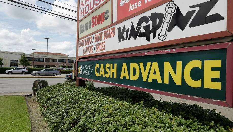 A sign for Advance America, 8574 Westheimer, is shown Thursday, Aug. 11, 2016, in Houston.  There has been a massive decline in the number of payday lenders since a city ordinance limiting their activity went into effect in 2014. Photo: Melissa Phillip, Houston Chronicle / © 2016 Houston Chronicle