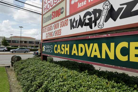A sign for Advance America, 8574 Westheimer, is shown Thursday, Aug. 11, 2016, in Houston.  There has been a massive decline in the number of payday lenders since a city ordinance limiting their activity went into effect in 2014.