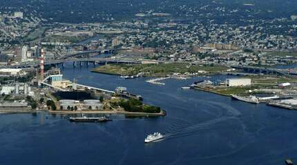 Aerial photo by Morgan Kaolian/AEROPIX The Bridgeport Harbor hasn't been dredged since 1964, and city and state officials familiar with the situation say that Bridgeport will lose much of its ability to market itself as a deep water port if something isn't done soon.