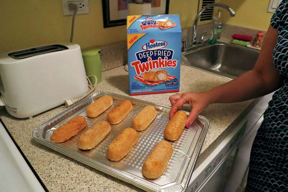 Frozen, deep-fried Twinkies are arranged on a tray before being baked. Hostess is launching packaged Deep Fried Twinkies that are a re-creation of the state fair fare. Photo: Mary Altaffer /Associated Press / Copyright 2016 The Associated Press. All rights reserved. This material may not be published, broadcast, rewritten or redistribu