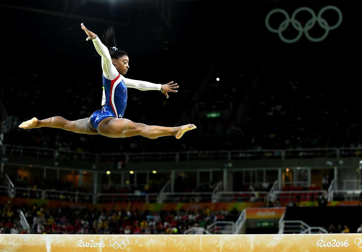 U.S. gymnast Simone Biles competes on the beam in the women's All-Around Individual at the Summer Olympics in Rio de Janeiro, Brazil, on Thursday, Aug. 11, 2016. Biles won the gold medal in the event. (Wally Skalij/Los Angeles Times/TNS)