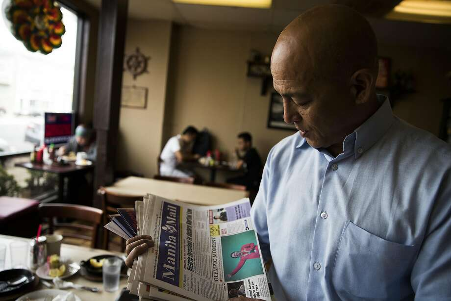 Daly City Council member Mike Guingona, who is running for San Mateo County Board of Supervisors, reads a Filipino newspaper during an interview with the Chronicle at Tselogs in Daly City, Calif. on Friday, Aug. 12, 2016. Guingona is the first Filipino-American councilman in Daly City where a third of its residents are of Filipino descent. Photo: Stephen Lam, Special To The Chronicle