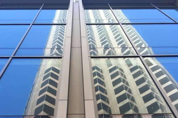 The iconic 555 California St., still known to many people as the Bank of America Building, as reflecting in its new neighbor 500 Pine St.
