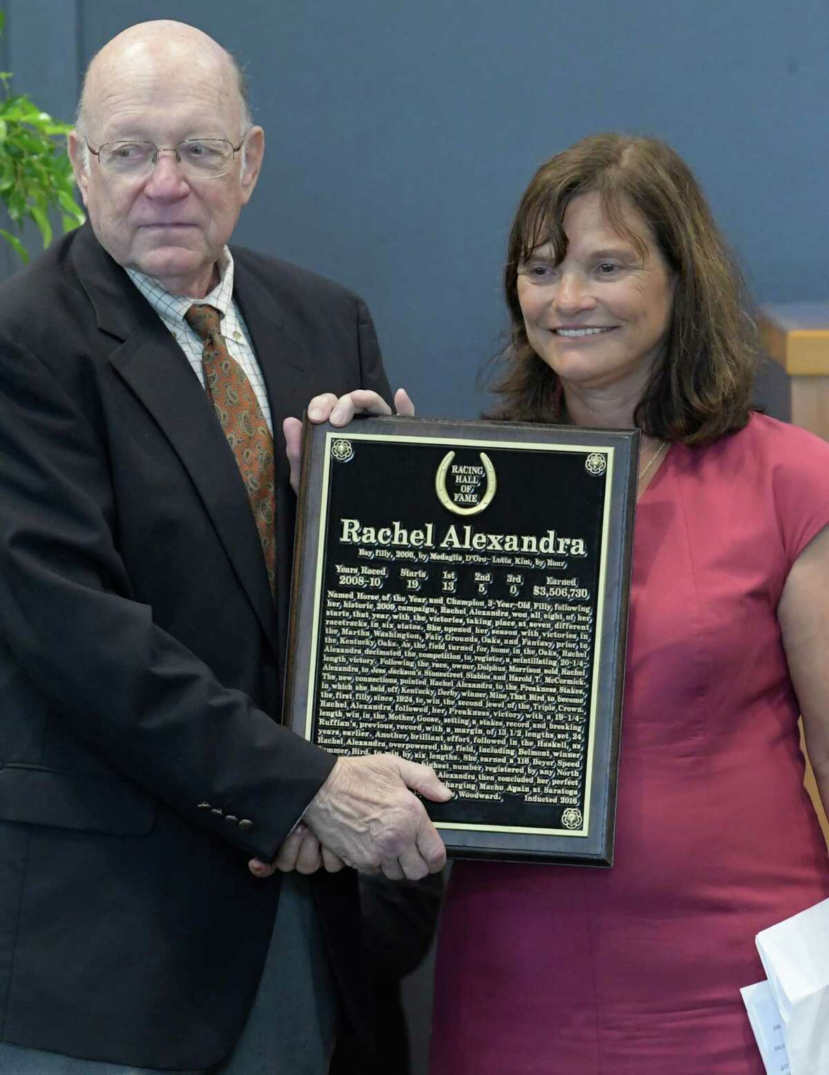 Barbara Banke receives the bronze plaque for the induction of her horse Rachel Alexandra from Ed Bowen of the Hall of Fame, in to the National Museum of Racing and Hall of Fame inductions at the Fasig-Tipton sales pavilion Friday Aug. 12, 2016 in Saratoga Springs, N.Y. (Skip Dickstein/Times Union)