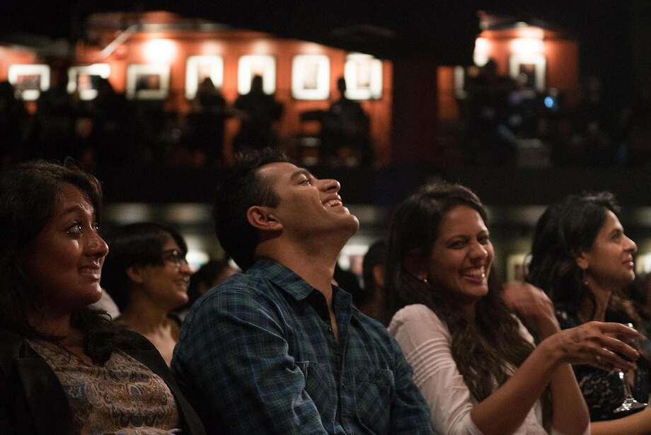 Audience members enjoy the Desi Comedy Fest at Cobb's Comedy Club, where comics also experimented with virtual reality. Photo: James Tensuan, Special To The Chronicle