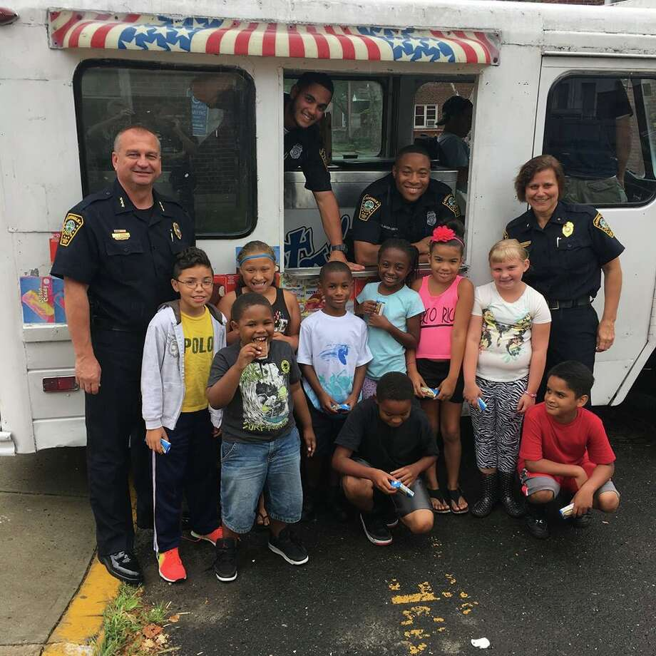 Hundreds of children were recently treated to a surprise delivery of frozen treats on Wednesday by Norwalk police officers and Mr. Frosty's Ice Cream. Photo: Contributed Photo