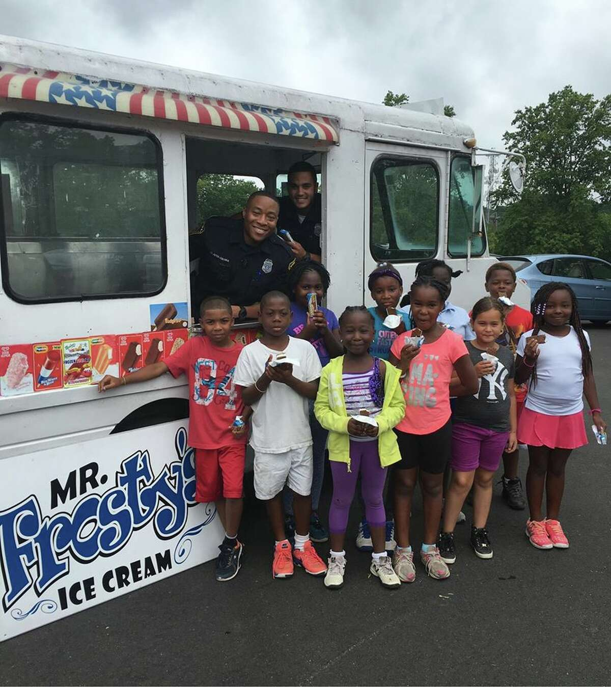 Hundreds of children were recently treated to a surprise delivery of frozen treats on Wednesday by Norwalk police officers and Mr. Frosty's Ice Cream.