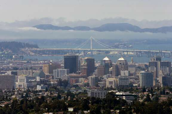 Looking across the bay to the skyline of Oakland, the Bay Bridge and the Marin Headlands from the hills of Oakland, California  on Fri. Aug. 12, 2016.