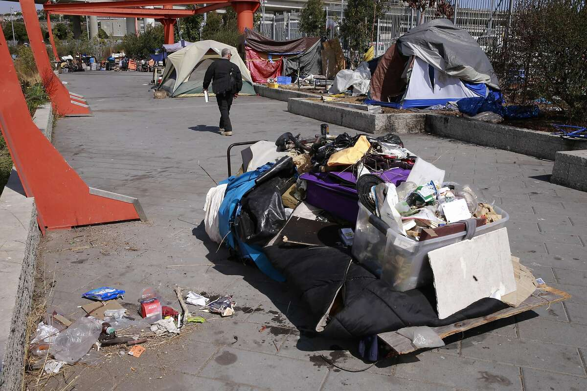 Encampment resolution team coordinator, Jason Albertson toured the Islais Creek homeless encampment telling the occupants where to go for shelter information and also when the city will remove their encampment in San Francisco, California, on Fri. Aug. 12, 2016.