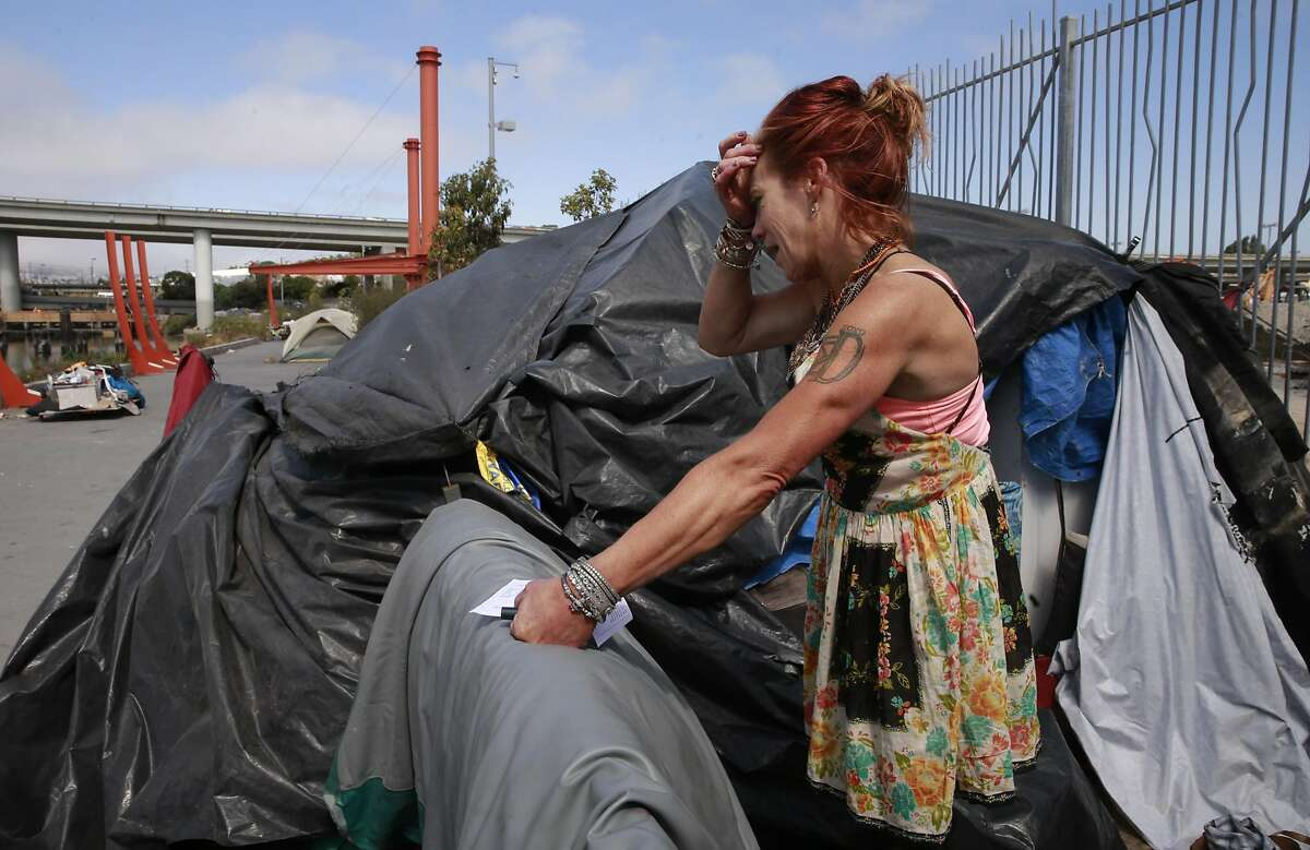 MIchelle homeless for the past year was interested in the shelter information as encampment resolution team coordinator, Jason Albertson toured the Islais Creek homeless encampment telling the occupants where to go for shelter information and also when the city will remove their encampment in San Francisco, California, on Fri. Aug. 12, 2016.