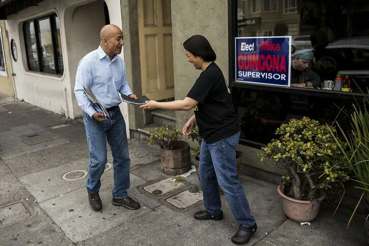 Daly City Council member Mike Guingona, left, who is running for San Mateo County Board of Supervisors, thanks a staff member of the Tselogs restaurant who ran out to return a belonging to him in Daly City, Calif. on Friday, Aug. 12, 2016. Guingona is the first Filipino-American councilman in Daly City where a third of its residents are of Filipino descent.