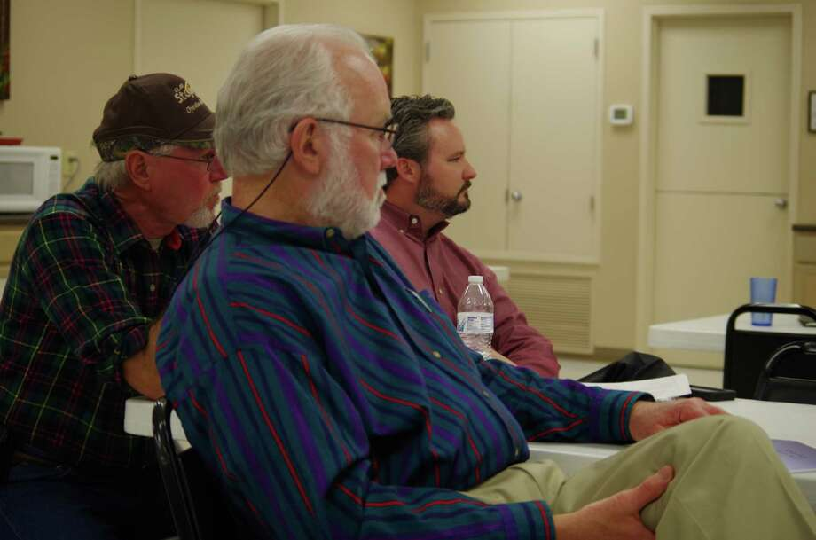 Helotes Mayor Thomas Schoolcraft, center, City Councilman Bert Buys and City Administrator Rick Schroder listen to a presentation in this 2015 file photo. Photo: /Joni Simon / For The Northwest L / Joni Simon