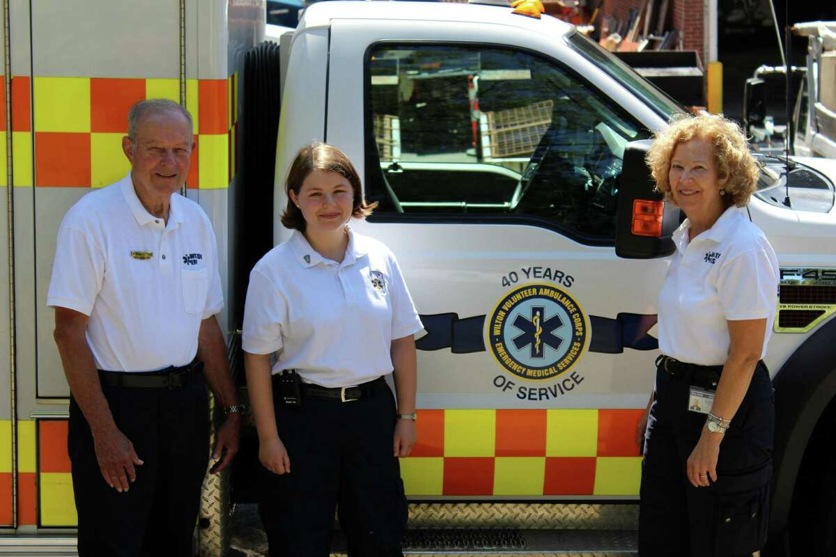 Wilton Volunteer Ambulance Corps members (from left to right): Ron Hitter, Hayley Siegel and President Wendy Fratino stand in front of the ambulance at the WVAC headquarters at234 Danbury Road on Thursday, Aug. 11, 2016.
