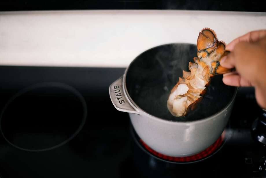 Boil the lobster tails in for two minutes and remove immediately before cutting each in half and either grilling or cooking in a fry pan. Photo: Nik Sharma