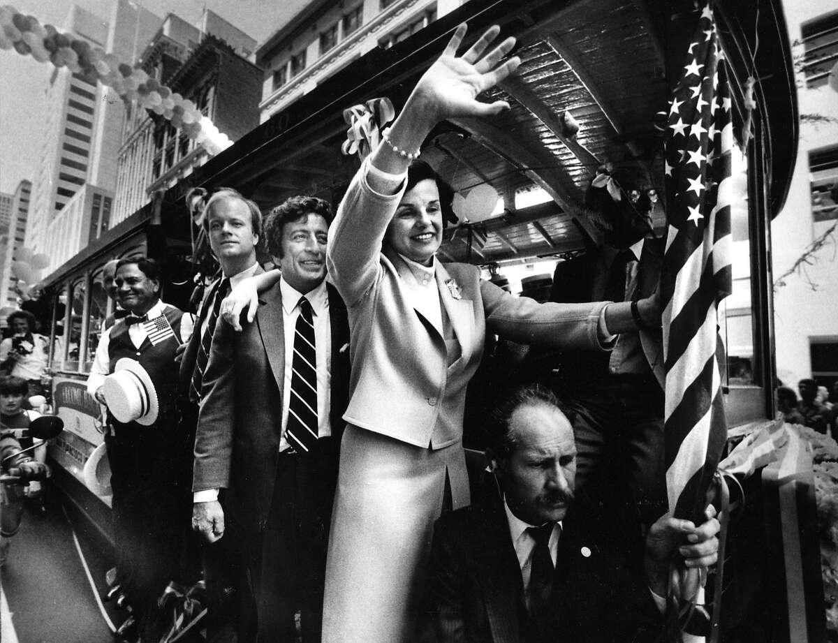 San Francisco mayor Dianne Feinstein, on a cable car with tony Bennett. June 22, 1984.