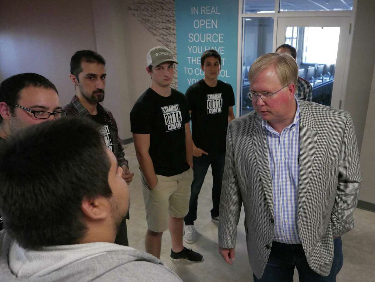 Graham Weston, co-founder and Chairman of Rackspace, speaks with students and staff in November. His nearly 19 million shares could be cashed out for more than half a billion dollars if the company sells.