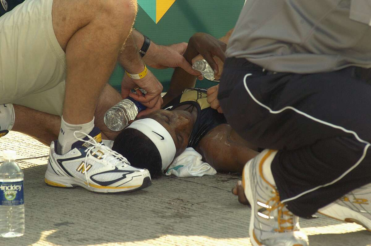 Berhane Adere of Ethopia collapses after winning the women's portion of the Chicago Marathon Sunday, Oct. 7, 2007, in Chicago. Stiffling heat and smothering humidity forced organizers of the Chicago Marathon to turn runners around Sunday, effectively ending the race for many thousands midway through the course.(AP Photo/Sun-Times, Brian Jackson) ** NO MAGS, NO SALES NO TV, CHICAGO LOCALS OUT; ROCKFORD REGISTER STAR OUT **