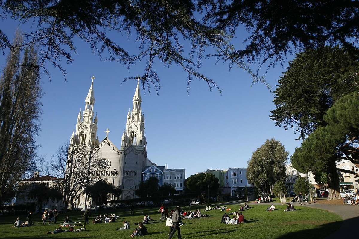 A view of Washington Square Park in the North Beach neighborhood, on Columbus Avenue in San Francisco. The Church of Saint Peter and Saint Paul can be seen in the background.