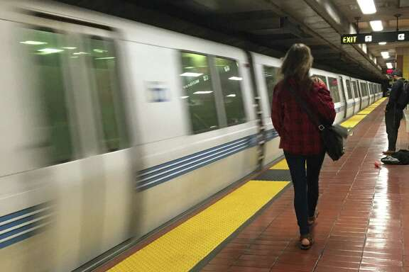 BART trains run after delays caused by equipment problems on the tracks that sparked small debris fires.