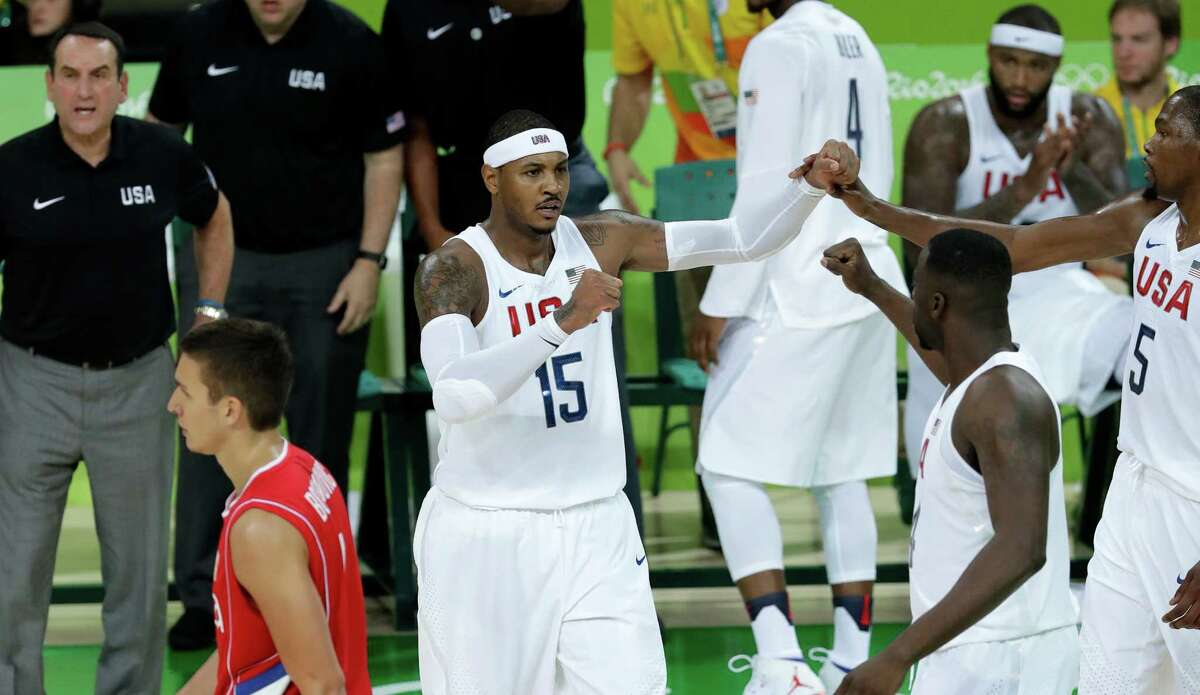 United States' Carmelo Anthony (15) celebrates with teammates after making a basket during a basketball game against Serbia at the 2016 Summer Olympics in Rio de Janeiro, Brazil, Friday, Aug. 12, 2016.