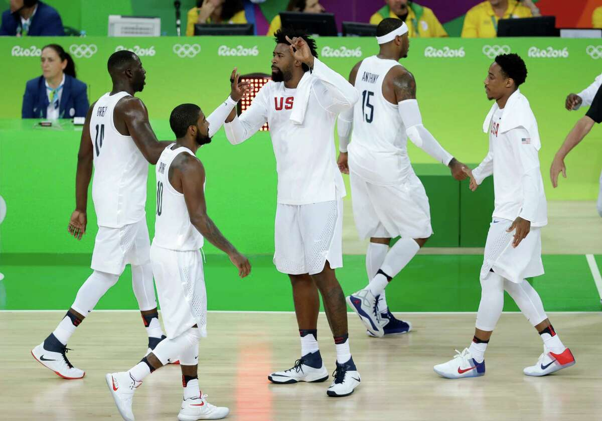 United States' DeAndre Jordan, center, celebrates with teammate during a basketball game against Serbia at the 2016 Summer Olympics in Rio de Janeiro, Brazil, Friday, Aug. 12, 2016.