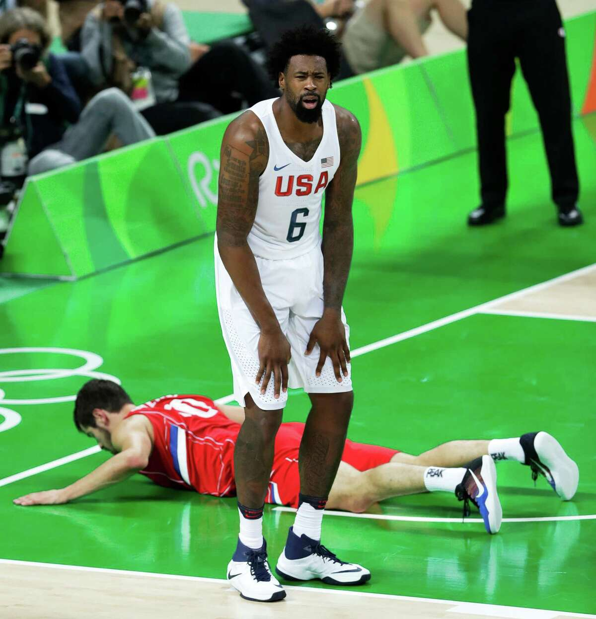United States' DeAndre Jordan (6) reacts in front of Serbia's Nikola Kalinic after being called for a foul during a basketball game at the 2016 Summer Olympics in Rio de Janeiro, Brazil, Friday, Aug. 12, 2016.