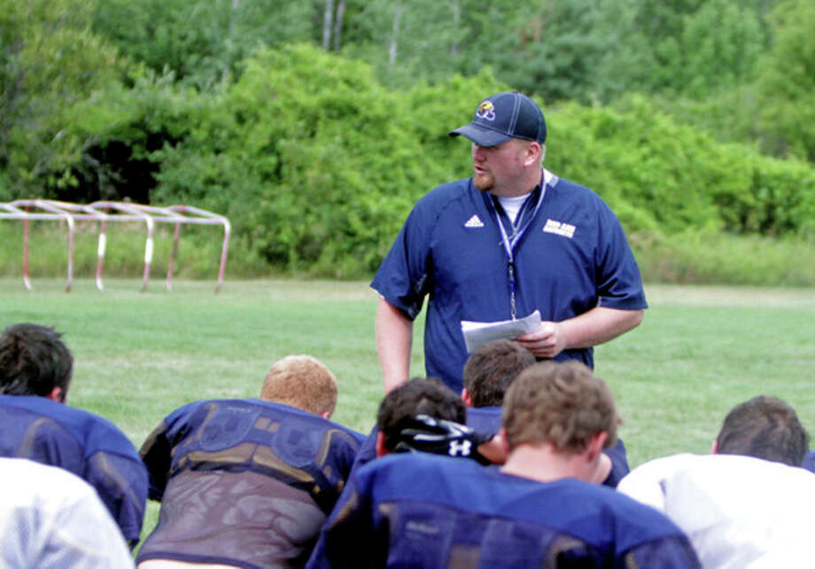 Bad Axe head football coach Kelly Durr talks to his players during practice, Friday, in Bad Axe. Durr takes over as head coach for Mark Manenti. It's been a smooth transition so far for Durr and the players. In 2015, Bad Axe finished 3-6, Durr is confident if his team can remain healthy, the Hatchets can improve on that mark.