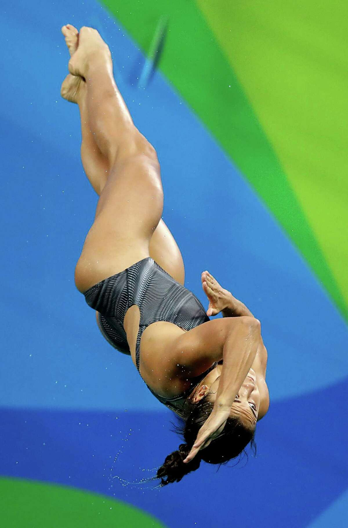 The Woodlands' Kassidy Cook placed eighth with a score of 327.75 during Friday's 3-meter springboard preliminary round. She moves on to the semifinals, which will be held Saturday.