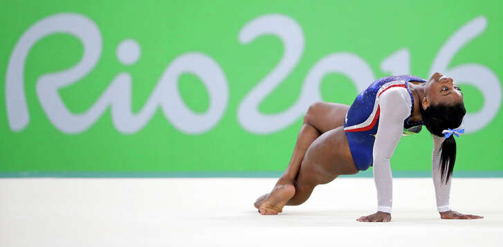 Simone Biles performs on the floor during the artistic gymnastics women's individual all-around final at the 2016 Summer Olympics in Rio de Janeiro.  (AP Photo/David Goldman)