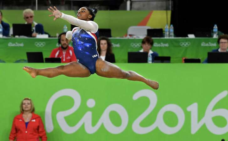 Spring's Simone Biles scord a 15.933 in the floor exercise to win the gold medal in the women's all-around Thursday. Although she has her two biggest competitions behind her, Biles will still compete in three event finals: vault, beam and floor exercise.