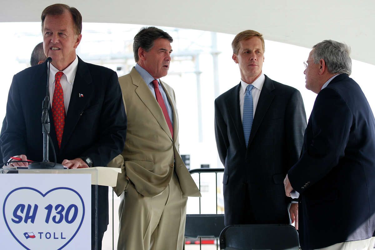 Texas Gov. Rick Perry (second from left) talks with Zachry Corp. President and CEO David S. Zachry (second from right) and Lockhart Mayor Lew White (right) before a ceremony for the opening of Texas 130 just west of Lockhart on Oct. 24, 2012. At the podium is SH 130 Concession Co. board member Joe Krier, also a member of the San Antonio City Council.
