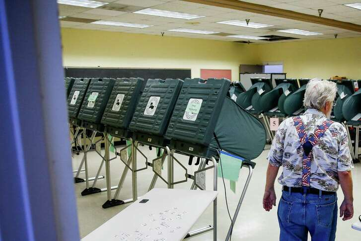 Election Clerk Chuck Hall walks through the voting room during the Democratic and Republican primary runoff elections at the Metropolitan Multi-Services Center on May 24 in Houston.