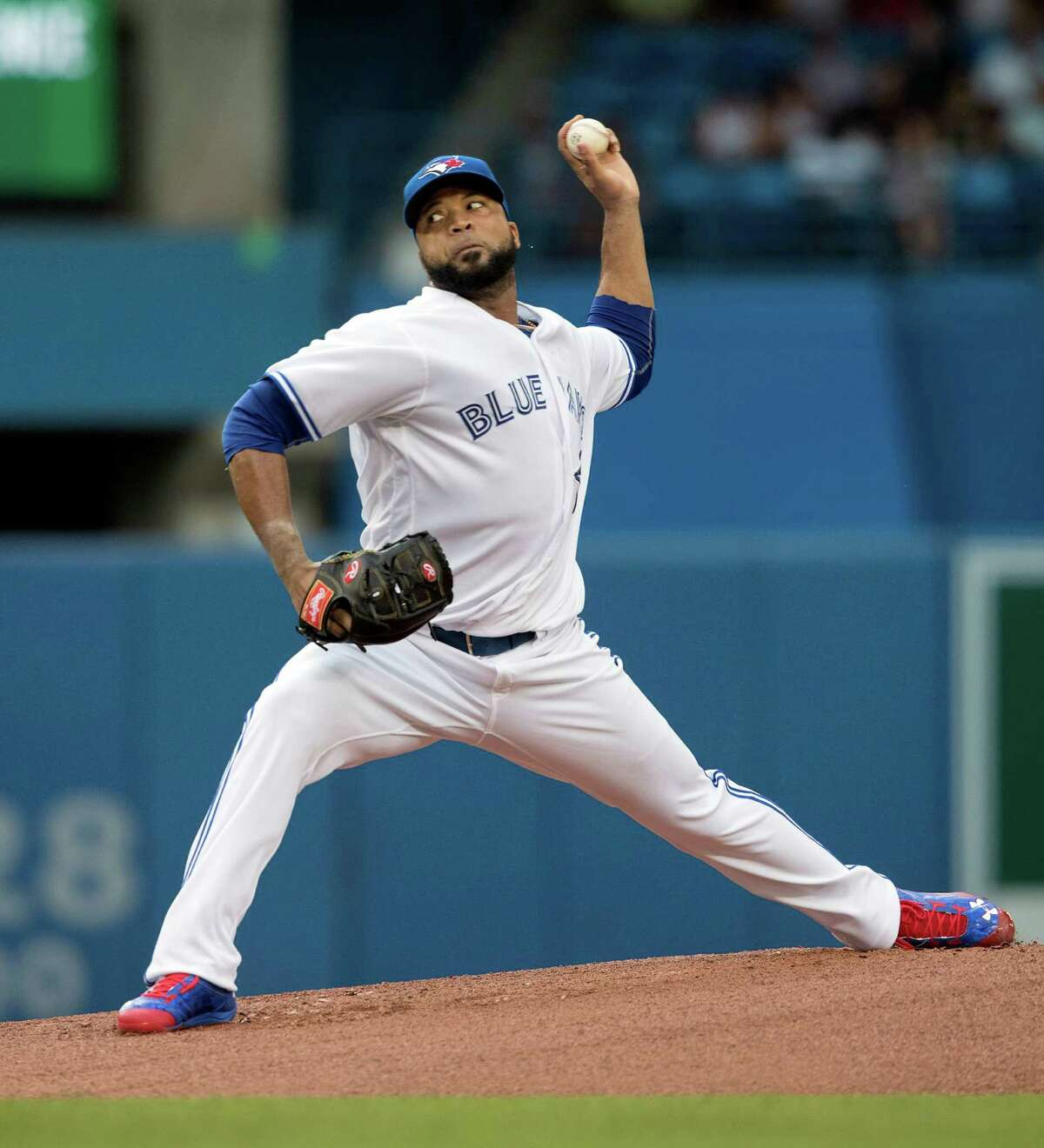 Toronto Blue Jays starting pitcher Francisco Liriano throws against the Houston Astros during the first inning of a baseball game in Toronto, Friday, Aug. 12, 2016. (Fred Thornhill/The Canadian Press via AP)