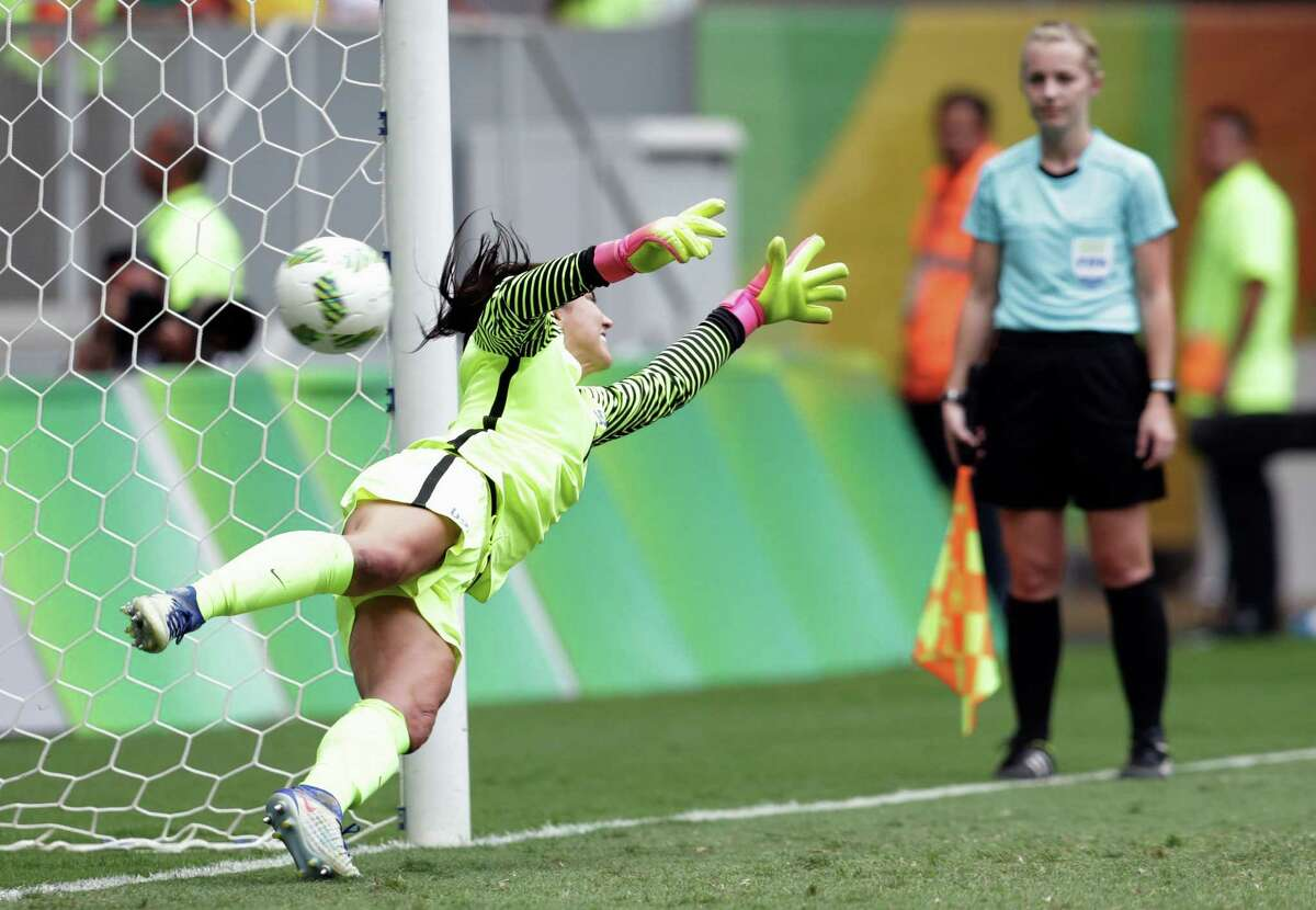 U.S. goalkeeper Hope Solo can't get a hand on a penalty kick during the shootout loss to Sweden that ousted the Americans.